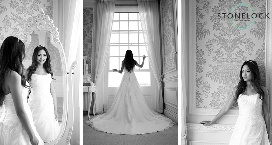 A bride gazes out of the window showing off the back of her dress