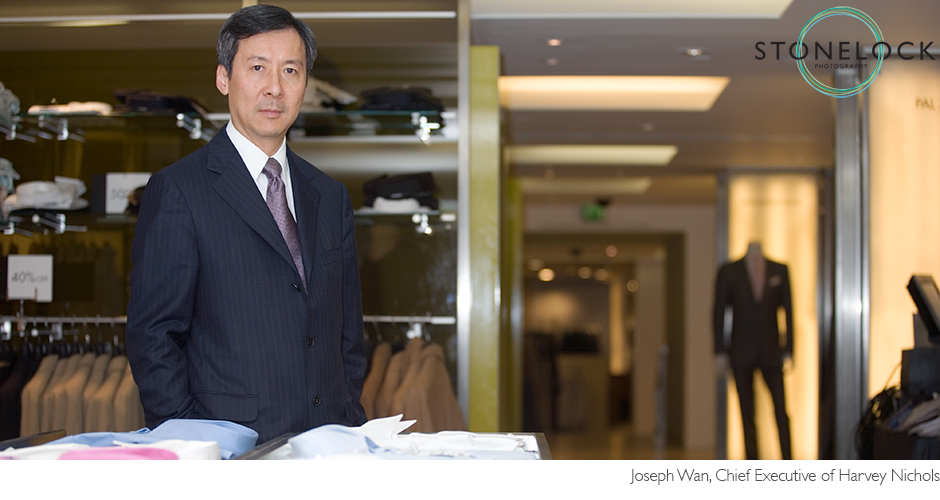 Joseph Wan the chief executive of Harvey Nichols stands in the menswear department and poses for the camera
