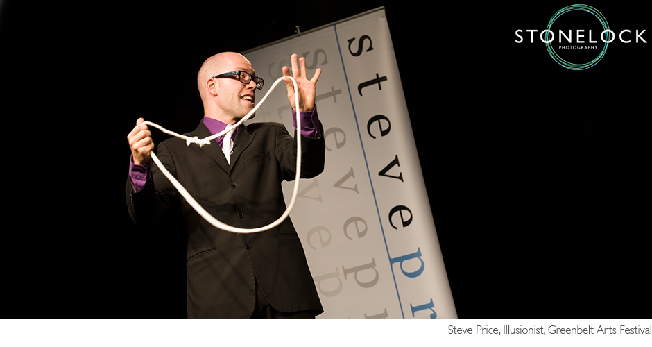 Illusionist Steve Prices performs a rope trick on a blacked out stage