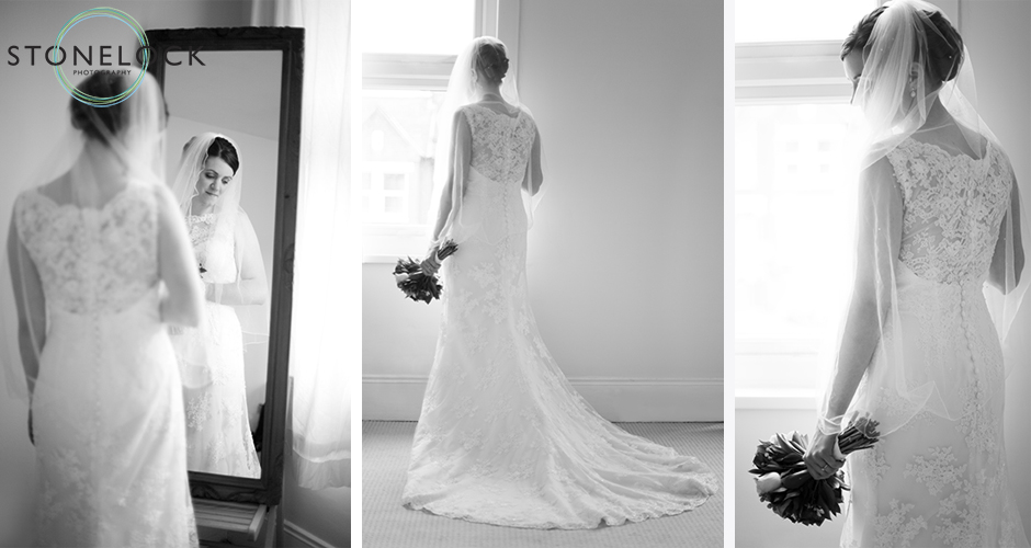 A bride poses in front of a window to show the back of her dress
