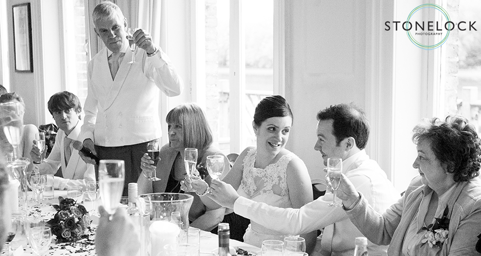 The father of the bride makes a toast to the happy couple during the speeches at their wedding