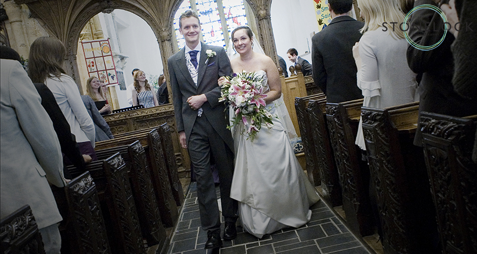 The bride and groom walk down the aisle of the Church as man and wife after their wedding ceremony