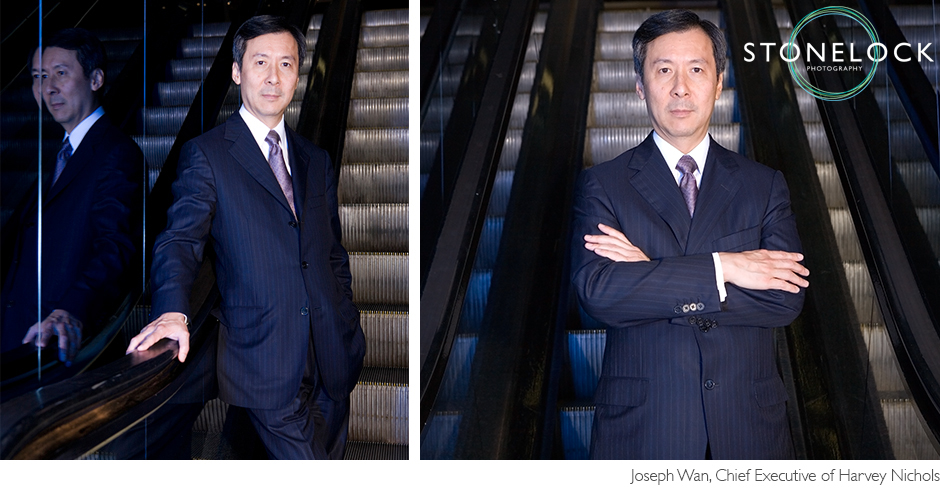 Joseph Wan, the chief executive of Harvey Nichols poses on the escalator in store