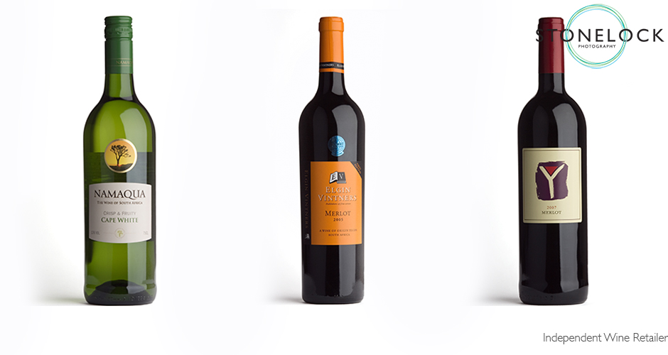 product photography, three wine bottles in a row with reflections in the glass