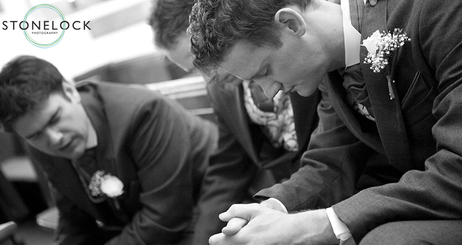 The groom and best men have a moments silence before the wedding ceremony