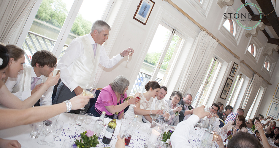 The father of the bride makes a toast to the bride and groom