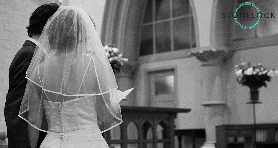 After the ceremony, the bride and groom stand to one side of the Church as the service continues