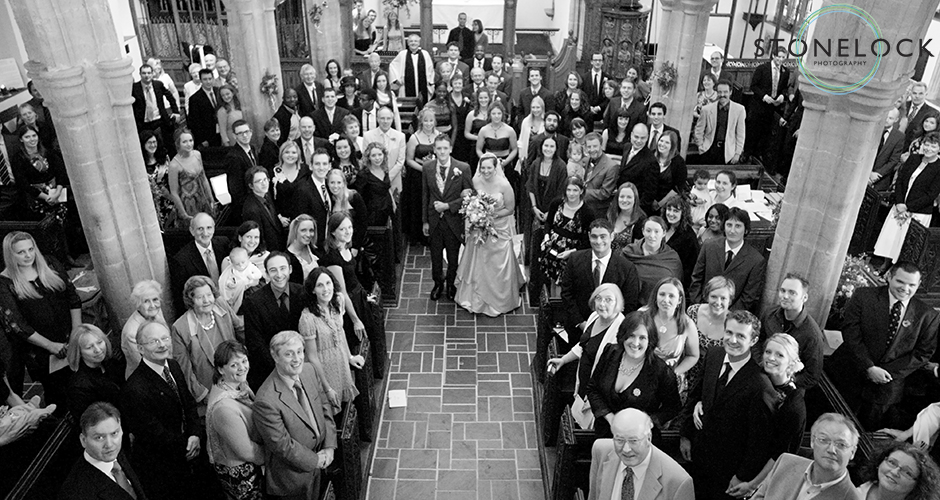 All the guest of the wedding shot from the balcony in the Church