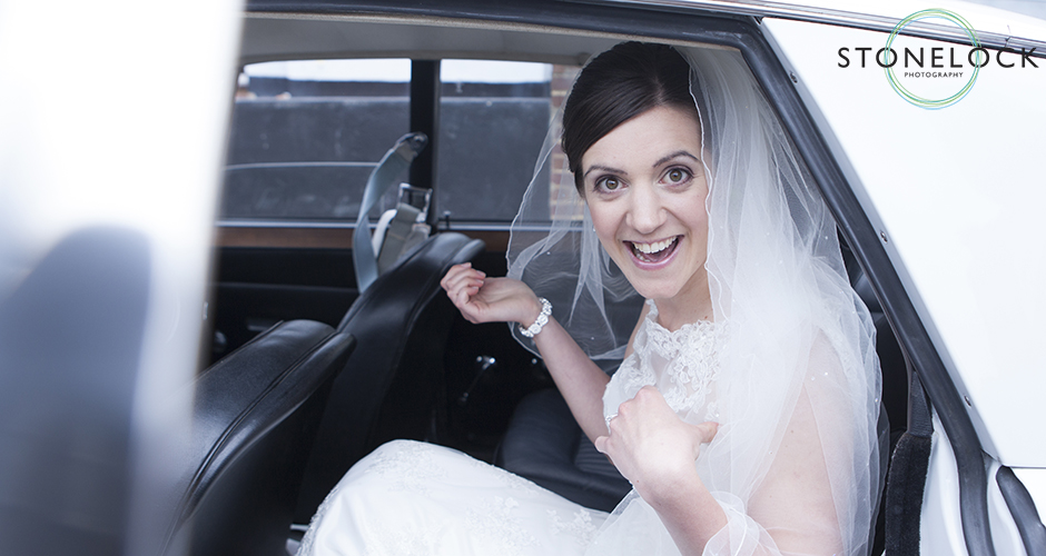 A bride sits in the wedding car on her way to be married