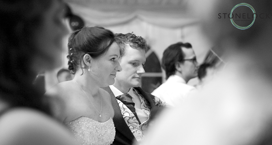 The bride and groom listen to the speeches