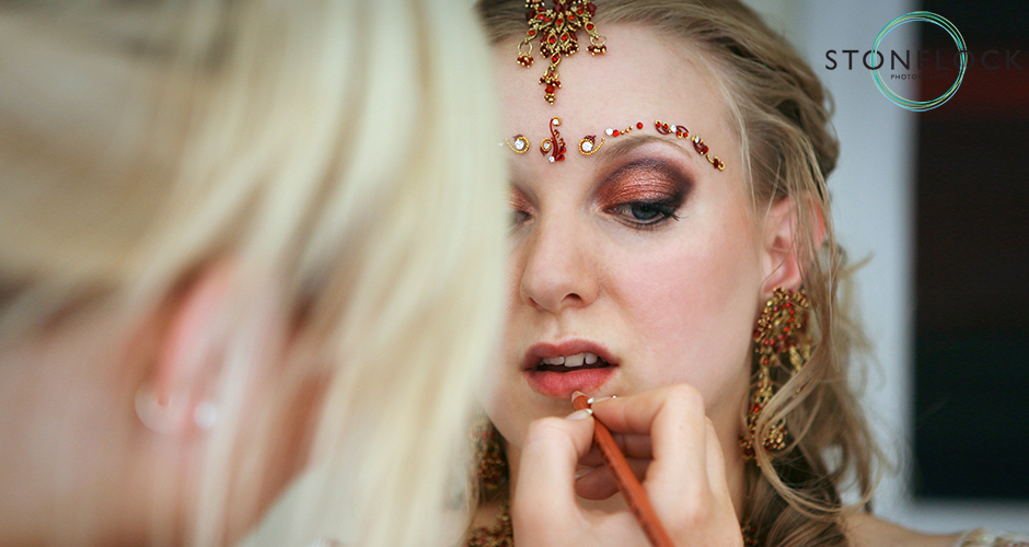 A bride gets her make-up done before her wedding