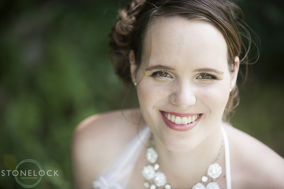 A portrait of a bride as she gazes directly at the camera