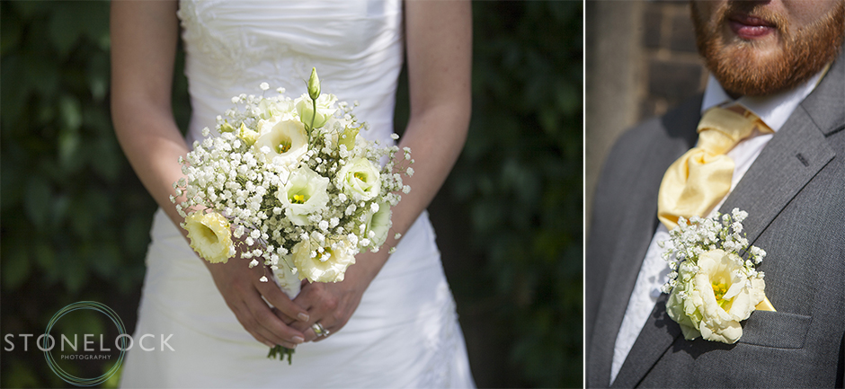 A close up photo of a bride holding her flowers and the grooms button hole