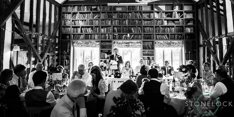 The wedding guests listen to the speeches shot in black & white