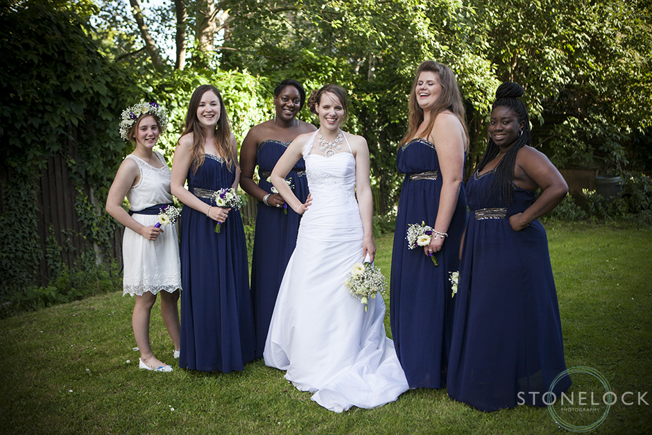 The bride and bridesmaids pose with attitude