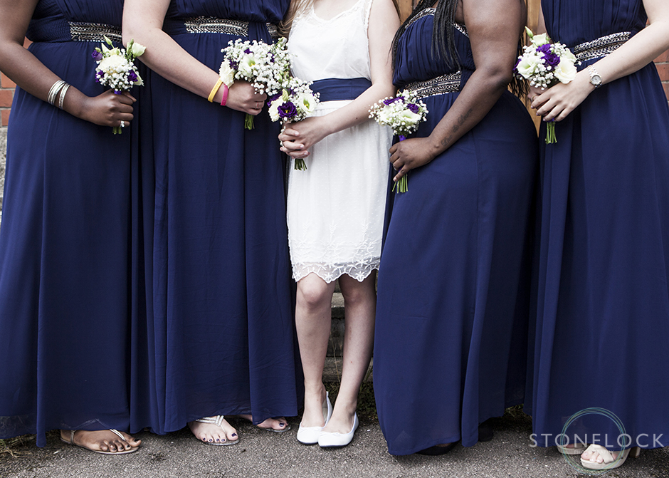 The bridesmaids hold their flowers