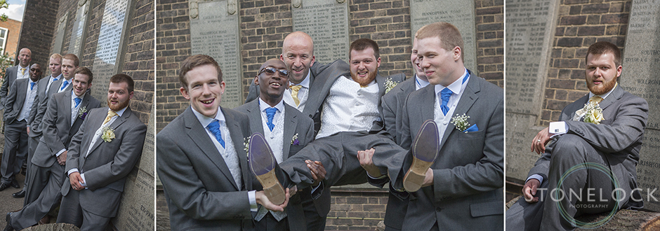 The best man, ushers and groomsmen pick up and carry the groom