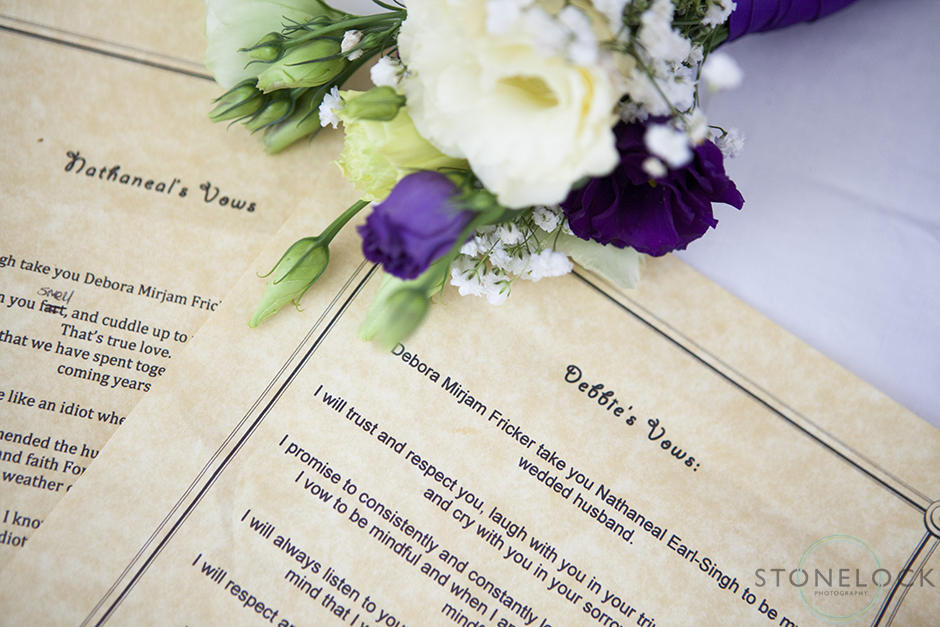 A photo of the bride and groom's wedding vows with the flowers