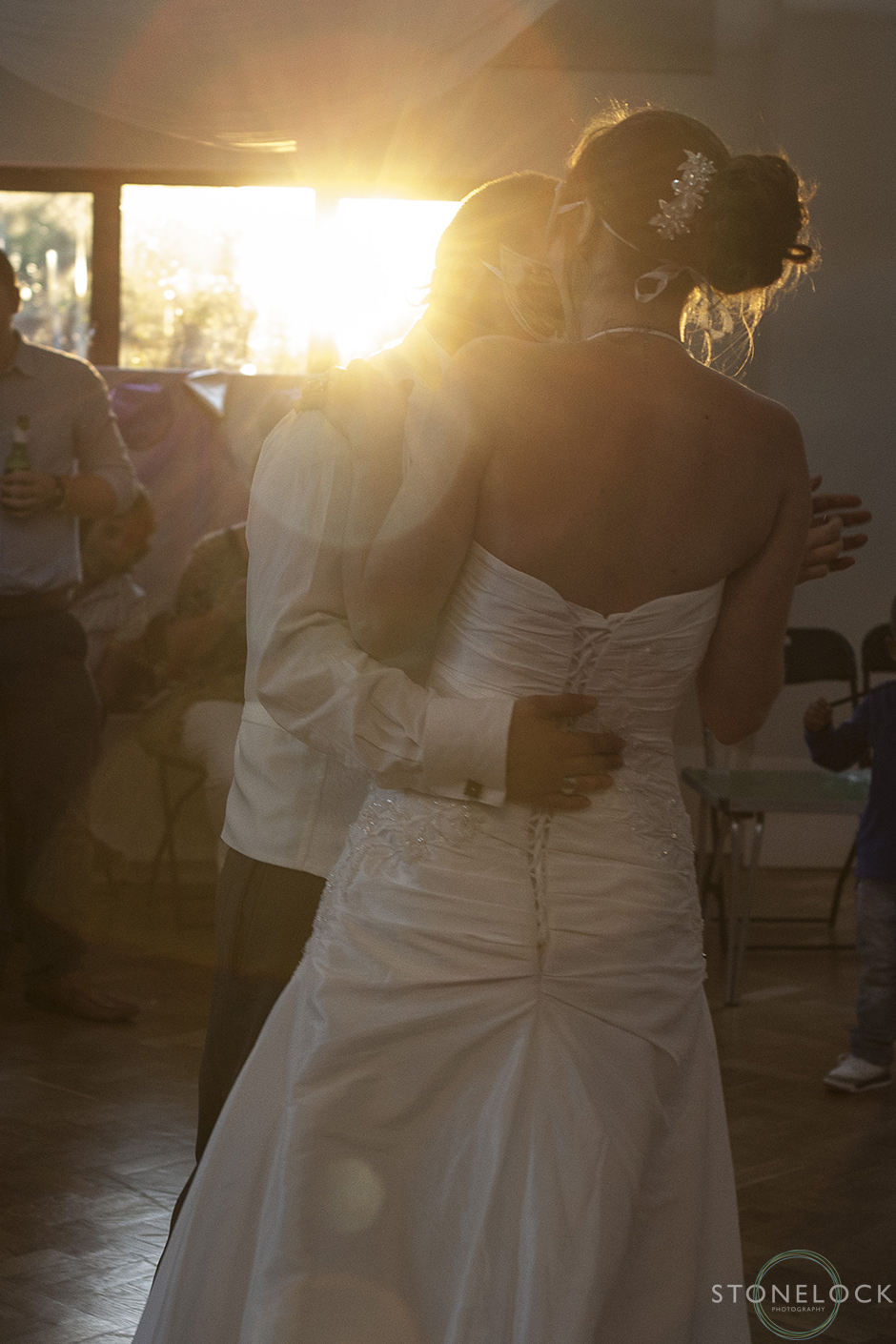 The first dance as the sun sets outside the window