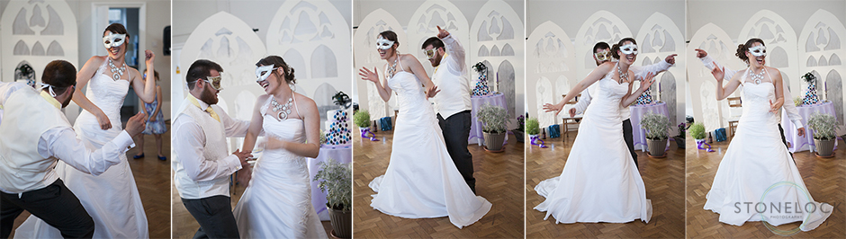 The bride and groom do their first dance wearing masks