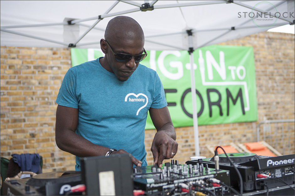 A DJ performs on his decks at the South Norwood Community Festival 2014