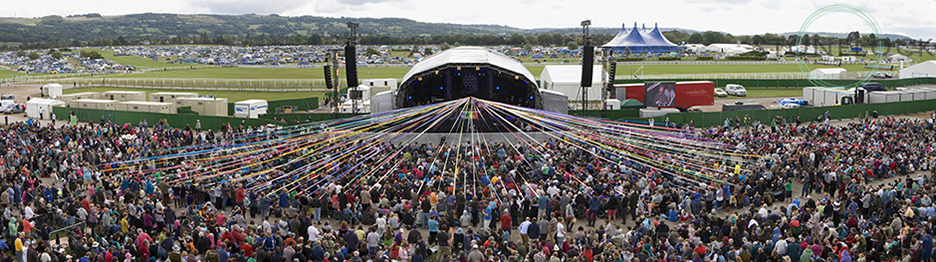 The Sunday morning communion service held at MainStage at Greeneblt Arts Festival, the crowds hold ribbons which feed back towards the centre of the stage