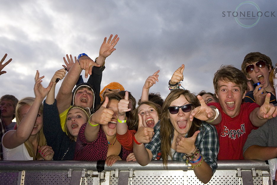 Crowds of fans at the front of MainStage at Greenbelt Arts Festival held at Cheltenham Racecourse