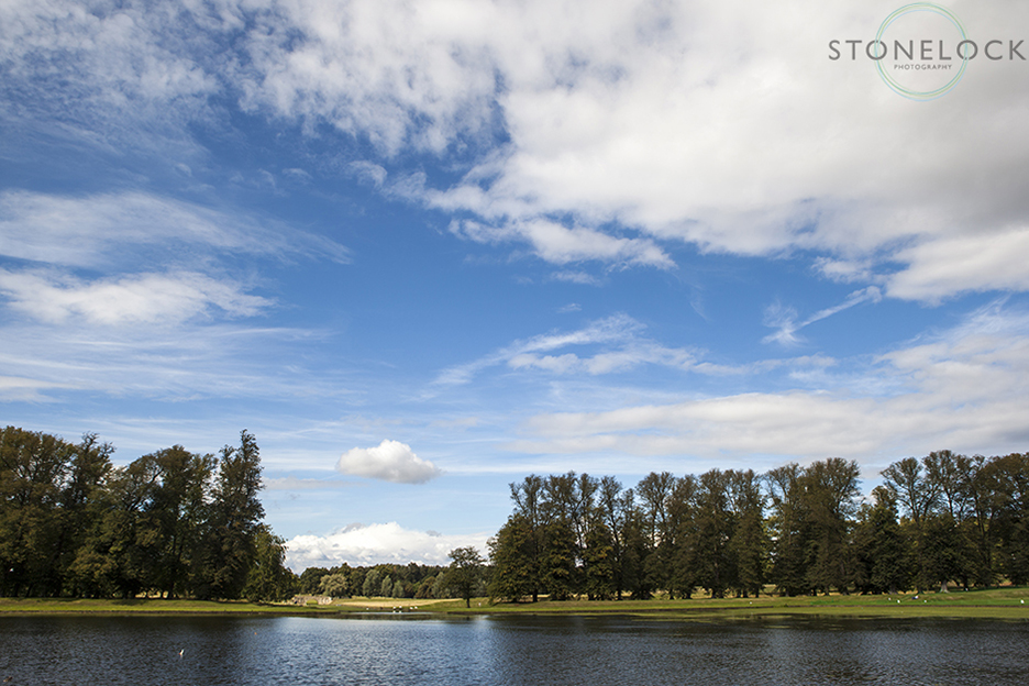 The lake at Boughton House, venue for Greenbelt Arts Festival with a stunning blue sky behind