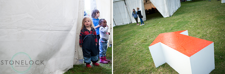 Kids stand outside a marque at Greenbelt Arts Festival in Boughton House