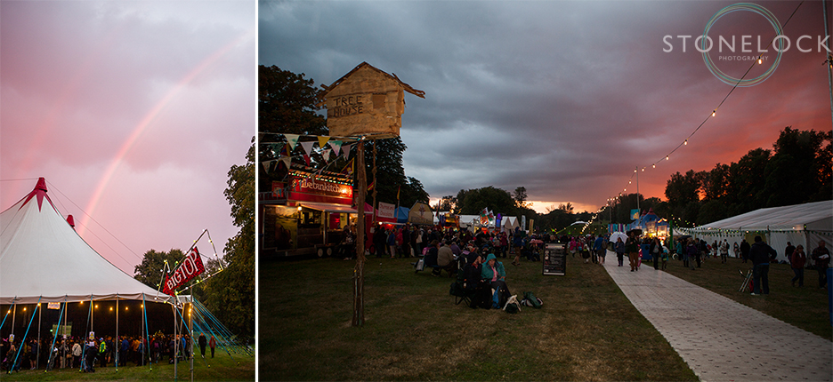 The sun sets on the Treehouse venue at Greenbelt Arts Festival at Boughton House whilst a rainbow sits behind the Big Top