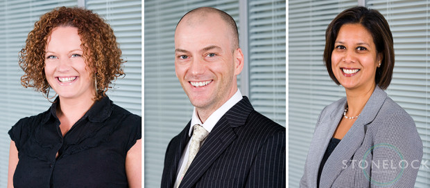 Professional business head shots, three business people pose for their photos for the company website