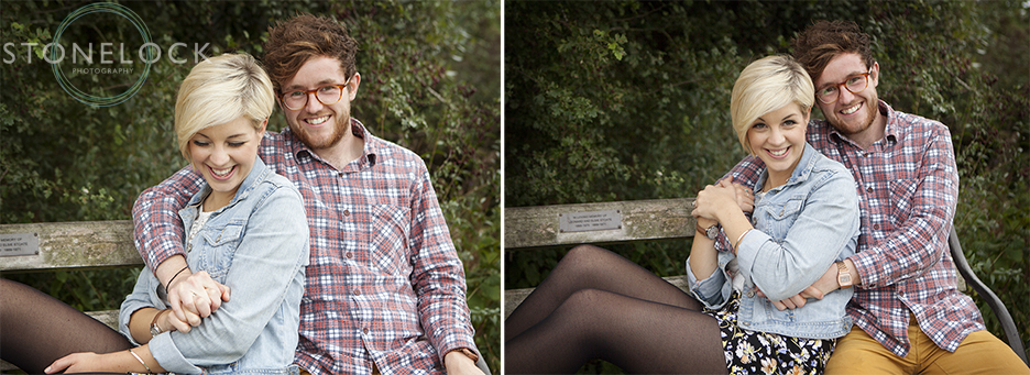 A couple relax on a bench and lean into each other during their engagement photo shoot in Bristol