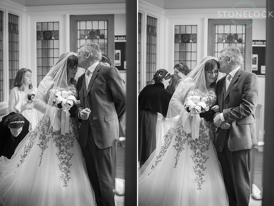 The bride and her father have quiet moment before they walk down the aisle