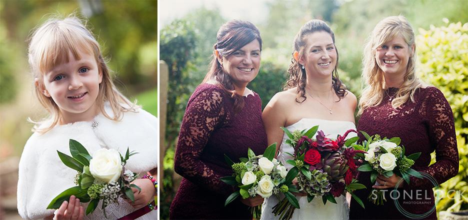 A bride and her bridesmaids pose for wedding photos
