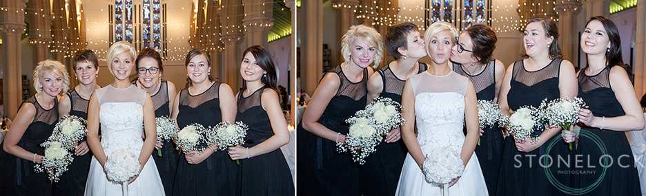 The bride poses with her bridesmaids and pulls a silly face as they kiss her on the cheeks