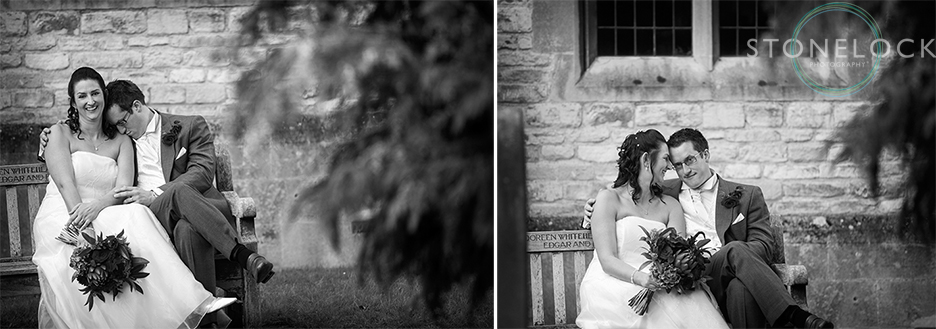 The bride and groom pose for some portraits on their wedding day, sitting on a bench they are more interested in each other than the camera!