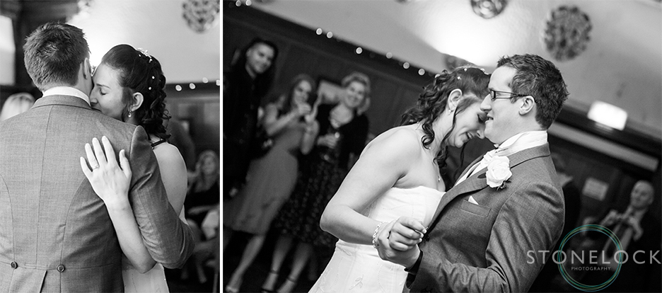The bride and groom share their first dance at their wedding reception at