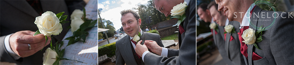 The ushers pin on their button holes before the wedding ceremony