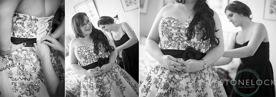 The bridesmaids help the bride put her wedding dress on