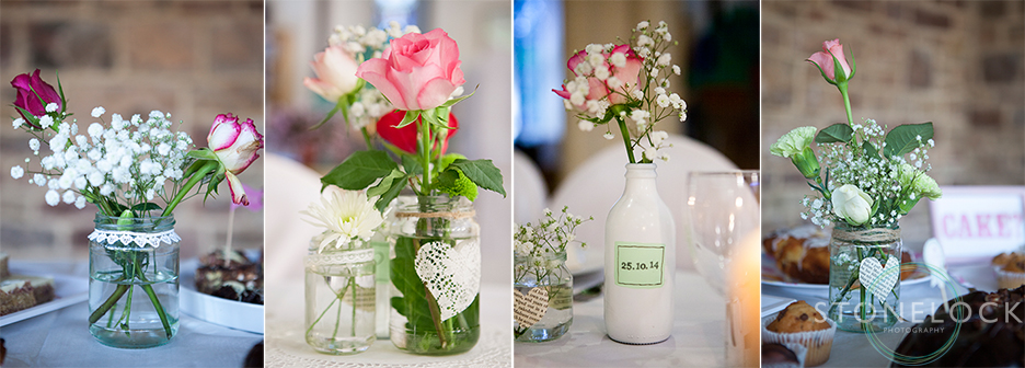 Flowers in jars sit on tables to decorate the wedding reception at St Mary Magdelene Church
