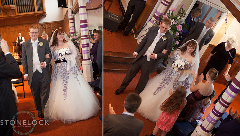 The bride and groom leave the church after the wedding ceremony at Mitcham Lane Baptist Church
