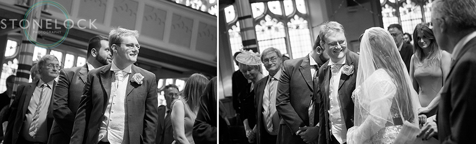Wedding photo in black and white of the bride enters the Church with her father as the groom looks on at Mitcham Lane Baptist Church