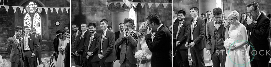 Wedding photo showing the emotions as the father of the bride walks his daughter down the aisle to meet the groom at Woodlands Church Bristol