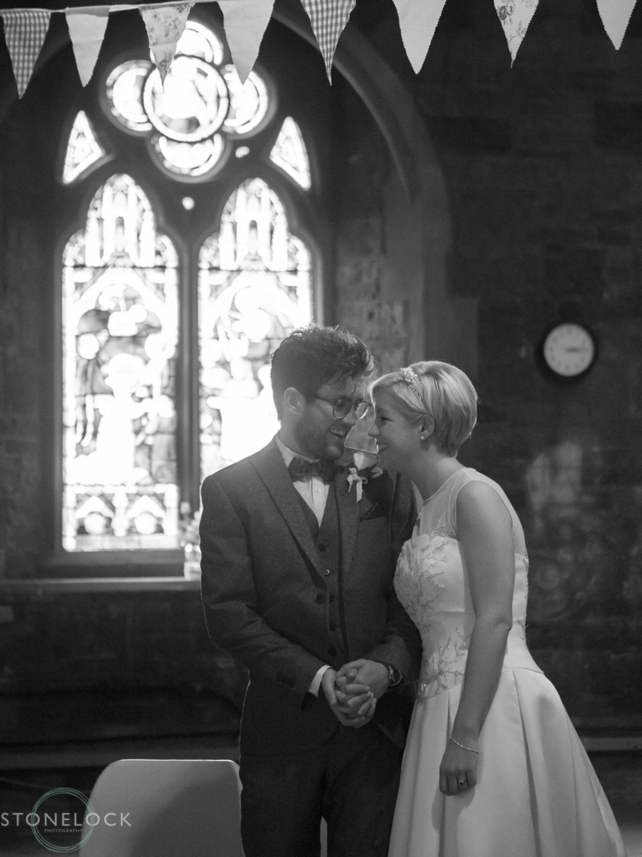 Wedding photography of a quiet moment between the bride and groom after they have said their wedding vows at Woodlands Church in Bristol