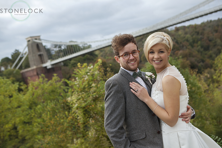 photo of the bride and groom in front of the clifton suspension bridge in bristol