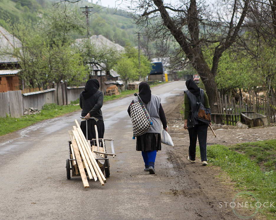 Women returning home after a days work, Botiza Village, Maramures, Romania