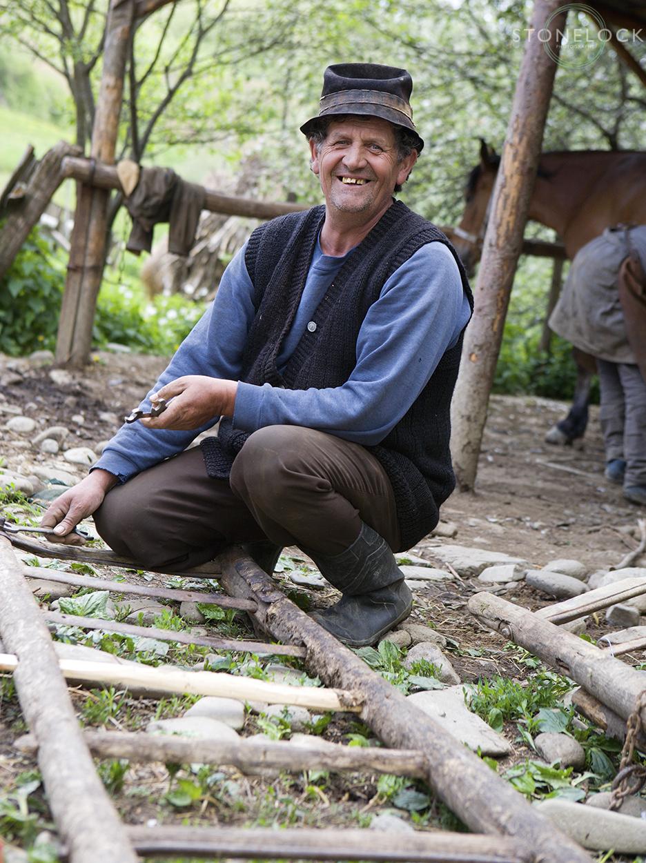 A worker at Ioan Bizau's blacksmiths, Bogdan Voda, Maramures, Romania,