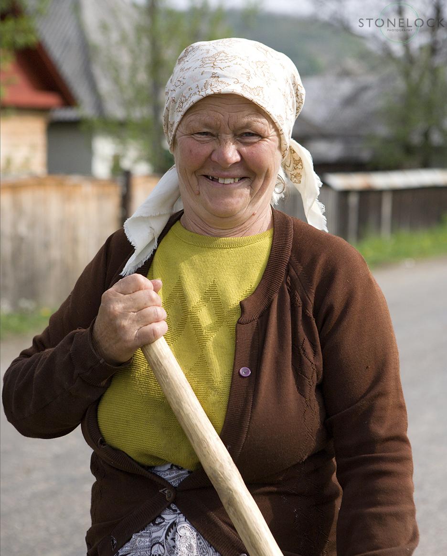 A lady, building her house, Sieu, Romania, Maramures,