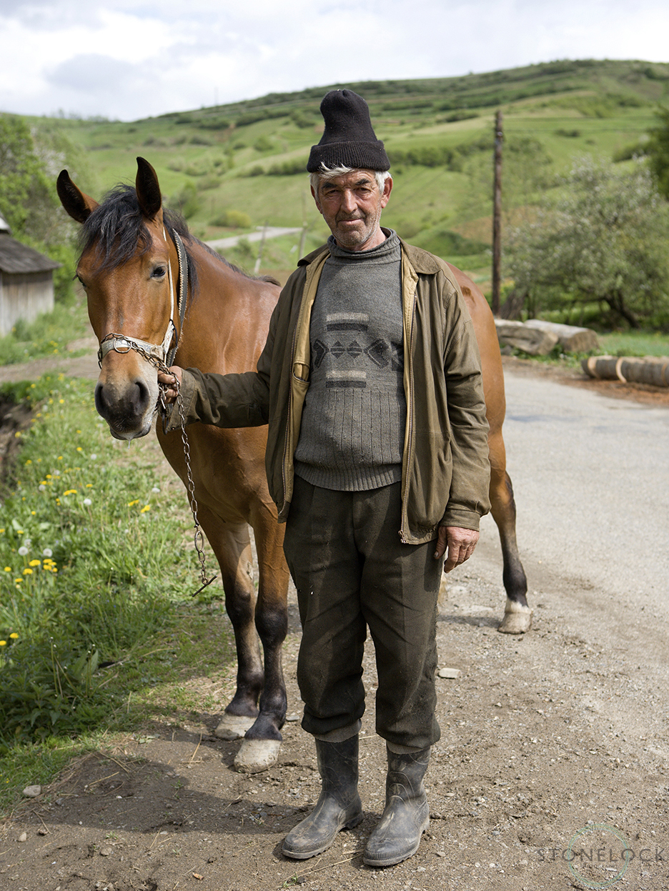 A man brings his horse to the blacksmith in Bogdan Voda, Maramures, Romania,