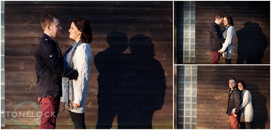 Engagement shoot in Finsbury Park North London, the couple stand in front of a wooden building